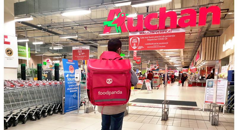 Auchan va livra cumparaturile online prin foodpanda Romania